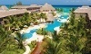 Reef Coco Beach Stay with Airfare from Vacation Express Coupons